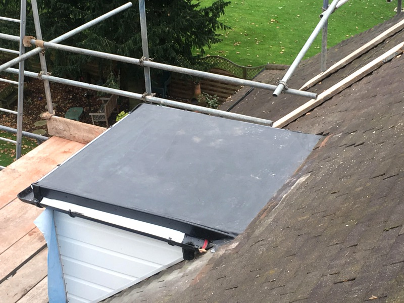 Fibre glass and torch, EPDM rubber roof, North Wales
